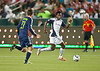 CARSON, CA – APRIL 30, 2011: New England Revolution midfielder Kenny Mansally (7) during the match between Chivas USA and New England Revolution at the Home Depot Center, April 30, 2011 in Carson, California. Final score Chivas USA 3, New England Revolution 0.