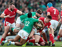 8th February 2020; Aviva Stadium, Dublin, Leinster, Ireland; International Six Nations Rugby, Ireland versus Wales; Josh Adams (Wales) is tackled by Bundee Aki (Ireland) and Iain Henderson (Ireland)