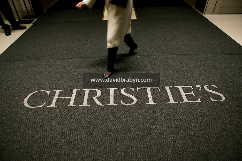 14 November 2006 - New York City, NY - An unidentified woman walks across the lobby of the Christie?s auction house in New York City, USA, 14 November 2006.