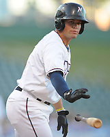 NWA Democrat-Gazette/ANDY SHUPE<br /> Northwest Arkansas Naturals catcher Parker Morin flips the bat away after drawing a walk against San Antonio Wednesday, Aug. 12, 2015, at Arvest Ballpark in Springdale.