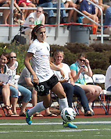 Portland Thorns FC forward Alex Morgan (13) brings the ball forward.  In a National Women's Soccer League (NWSL) match, Portland Thorns FC (white) defeated Boston Breakers (blue), 2-1, at Dilboy Stadium on July 21, 2013.