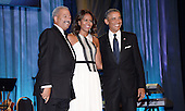 United States President Barack Obama, right, and first lady Michelle Obama, center, pose on stage with U.S. Representative Chaka Fattah (Democrat of New York) for the Congressional Black Caucus Foundation Annual Phoenix Awards dinner at the Walter E. Washington Convention Center, September 27, 2014 in Washington, DC. The CBC's annual conference brings together activists, politicians and business leaders to discuss public policy impacting Black communities in America and abroad. <br /> Credit: Olivier Douliery / Pool via CNP