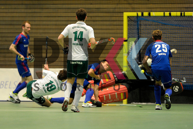 GER - Luebeck, Germany, February 06: During the 1. Bundesliga Herren indoor hockey semi final match at the Final 4 between Uhlenhorst Muelheim (white) and Mannheimer HC (blue) on February 6, 2016 at Hansehalle Luebeck in Luebeck, Germany.  Final score 2-3 (HT 7-5).  Jan Nitschke #19 of HTC Uhlenhorst Muehlheim, Timm Herzbruch #14 of HTC Uhlenhorst Muehlheim, Andreas Spaeck #1 of Mannheimer HC, Florian Woesch #25 of Mannheimer HC<br /> <br /> Foto &copy; PIX-Sportfotos *** Foto ist honorarpflichtig! *** Auf Anfrage in hoeherer Qualitaet/Aufloesung. Belegexemplar erbeten. Veroeffentlichung ausschliesslich fuer journalistisch-publizistische Zwecke. For editorial use only.