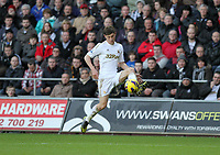 Barclays Premier League, Swansea City (White) V Norwich City (black) Liberty Stadium, Swansea, 08/12/12<br /> Pictured: Swansea's Ben Davies<br /> Picture by: Ben Wyeth / Athena <br /> Athena Picture Agency<br /> info@athena-pictures.com