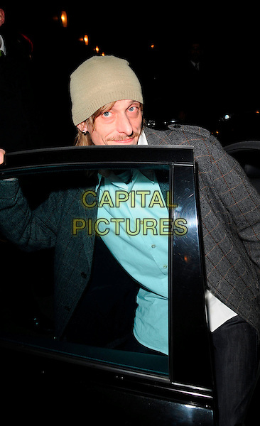 McKENZIE CROOK.At The Ivy Restaurant,.London, England, .April 5th 2008..half length green khaki beanie hat long hair white shirt grey plaid jacket getting into car.CAP/CAN.©Can Nguyen/Capital Pictures