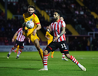 Lincoln City's Bruno Andrade vies for possession with Northampton Town's Jordan Turnbull<br /> <br /> Photographer Chris Vaughan/CameraSport<br /> <br /> Emirates FA Cup First Round - Lincoln City v Northampton Town - Saturday 10th November 2018 - Sincil Bank - Lincoln<br />  <br /> World Copyright &copy; 2018 CameraSport. All rights reserved. 43 Linden Ave. Countesthorpe. Leicester. England. LE8 5PG - Tel: +44 (0) 116 277 4147 - admin@camerasport.com - www.camerasport.com