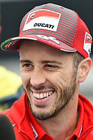 October 24, 2018: MotoGP rider Andrea Dovizioso speaks to the media after playing tennis with Jack Miller at Melbourne Park before the 2018 MotoGP of Australia to be held at Phillip Island Grand Prix Circuit, Victoria, Australia. Photo Sydney Low