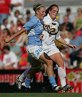 OCT 2, 2005: College Park, MD, USA:  UNC Tarheel forward #30 Elizabeth Guess fights for the ball with Maryland Terrapins defender #3 Kimberly Bunting at Ludwig Field.  UNC won, 4-0. Mandatory Credit: Photo By Brad Smith (c) Copyright 2005 Brad Smith