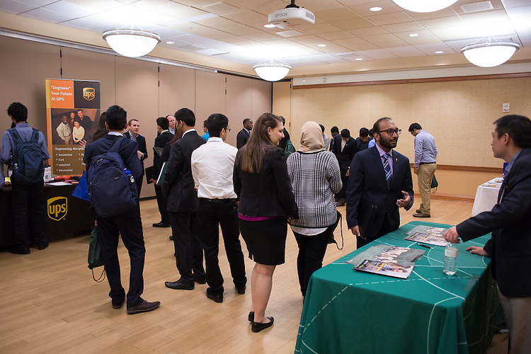 Students from various universities talk to representatives from different companies about job and internship opportunities at the Institute of Industrial and Systems Engineering Regional Conference in Baker Center on Feb. 25, 2017.