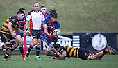 Savelio Ropati gets the pass away as he is taken to ground by Johnathan Kawau. Counties Manukau Premier 1 McNamara Cup Final between Ardmore Marist and Bombay, played at Navigation Homes Stadium on Saturday July 20th 2019.<br />  Bombay won the McNamara Cup for the 5th time in 6 years, 33 - 18 after leading 14 - 10 at halftime.<br /> Photo by Richard Spranger.
