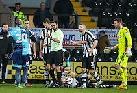 Referee Eddie Ilderton waves Adebayo Akinfenwa of Wycombe Wanderers away after handing floored Michael O'Connor of Notts Co a red card during the Sky Bet League 2 match between Notts County and Wycombe Wanderers at Meadow Lane, Nottingham, England on 10 December 2016. Photo by Andy Rowland.