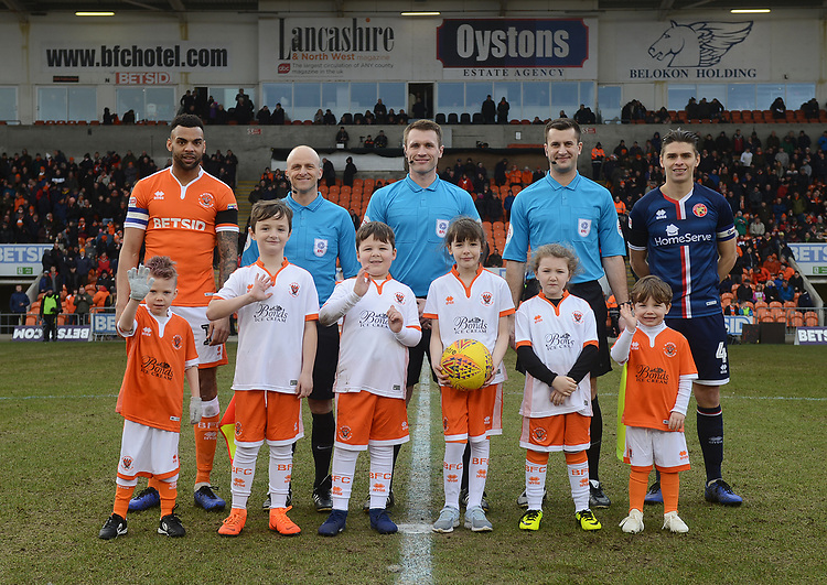 Blackpool's Curtis Tilt (left) and Walsall's George Dobson (right) line up with match officials and mascots<br /> <br /> Photographer Kevin Barnes/CameraSport<br /> <br /> The EFL Sky Bet League One - Blackpool v Walsall - Saturday 9th February 2019 - Bloomfield Road - Blackpool<br /> <br /> World Copyright &copy; 2019 CameraSport. All rights reserved. 43 Linden Ave. Countesthorpe. Leicester. England. LE8 5PG - Tel: +44 (0) 116 277 4147 - admin@camerasport.com - www.camerasport.com