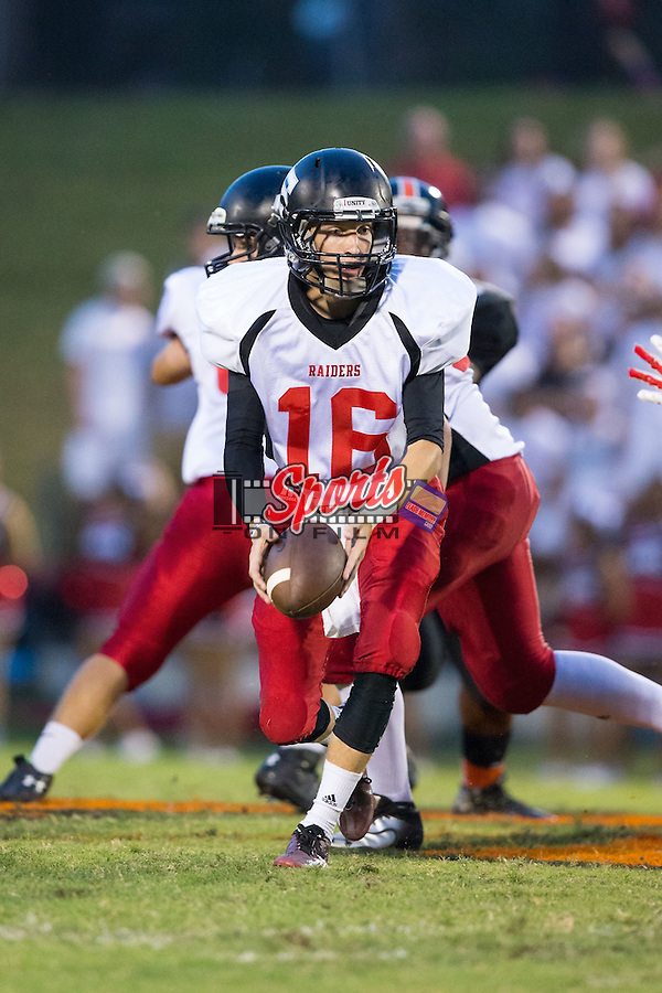 South Rowan Raiders quarterback Heath Barringer (16) turns to pitch the ball during first half action against the Northwest Cabarrus Trojans at Trojan Stadium September 12, 2014, in Concord, North Carolina.  (Brian Westerholt/Sports On Film)