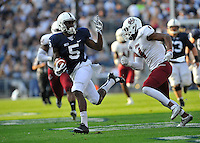 20 September 2014:  Penn State WR DaeSean Hamilton (5) runs from UMass DB Randall Jette (4).The Penn State Nittany Lions vs. the University of Massachusetts Minutemen at Beaver Stadium in State College, PA.