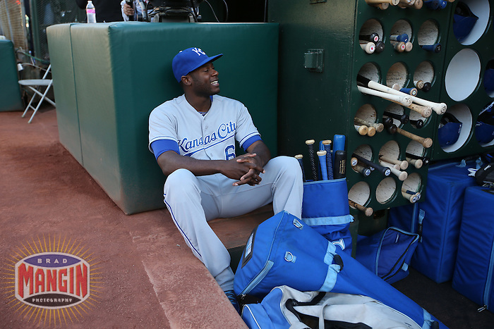 OAKLAND, CA - AUGUST 1:  Lorenzo Cain #6 of the Kansas City Royals sits in the dugout before the game against the Oakland Athletics at O.co Coliseum on Friday, August 1, 2014 in Oakland, California. Photo by Brad Mangin