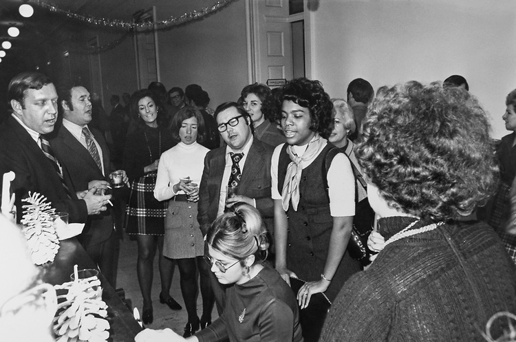 Congressmen and staff members enjoying Christmas a party. (Photo by Dev O'Neill/CQ Roll Call via Getty Images)