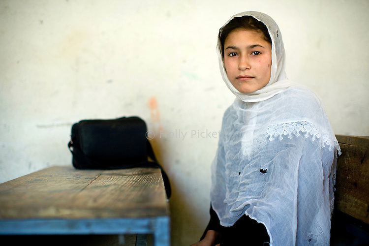 Ameenah, 13, is in seventh-grade in the girls' high school in Farghamanch, Jurm district, Badakhshan province, Afghanistan, Saturday morning, Oct. 24, 2009. She said she wants to use her education to become a doctor. As the Obama Administration seeks the formula for turning the tide of the war in Afghanistan, some aid organizations are advocating the National Solidarity Programme, a community-based development program that has made progress in some districts, setting up local councils that propose much-needed projects such as schools, drinking water facilities and roads.