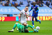 David Marshall of Wigan Athletic battles with Connor Roberts of Swansea City during the Sky Bet Championship match between Wigan Athletic and Swansea City at The DW Stadium in Wigan, England, UK. Saturday 2 November 2019