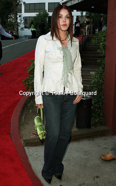 Priscilla Presley  arriving at 13th Annual American Society Of Young Musicians Spring Benefit Concert and Awards Show at the House Of Blues in Los Angeles June 9, 2005.
