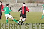 St Brendan's Park's Owen McMahon and Castlisland's Denis Collins.