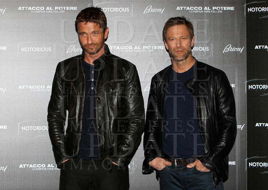"L'attore scozzese Gerard Butler, sinistra, e lo statunitense Aaron Eckhart posano durante il photocall del film ""Attacco al potere"" a Roma, 5 aprile 2013..British actor Gerard Butler, left, and U.S. actor Aaron Eckhart pose during the photocall of the movie ""Olympus has fallen"" in Rome, 5 April 2013..UPDATE IMAGES PRESS/Isabella Bonotto."