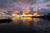 A brilliant and colorful sunrise over the calm waters of Kaneohe Bay, O'ahu.
