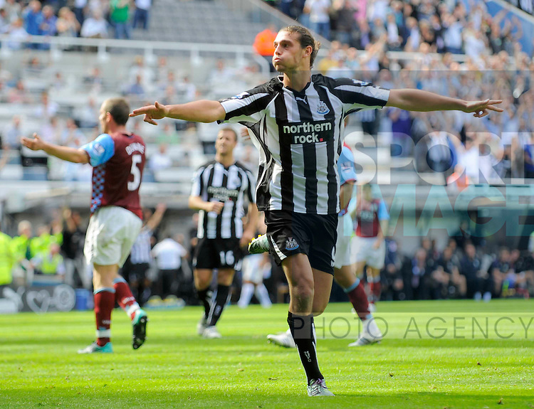 Newcastle's Andy Carroll celebrates scoring his side's sixth goal and his third.