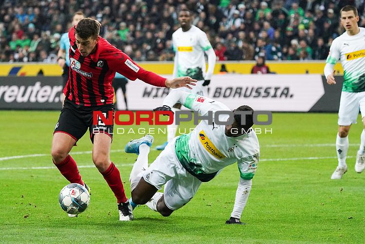 01.12.2019, Borussia Park , Moenchengladbach, GER, 1. FBL,  Borussia Moenchengladbach vs. SC Freiburg,<br />  <br /> DFL regulations prohibit any use of photographs as image sequences and/or quasi-video<br /> <br /> im Bild / picture shows: <br /> JANIK HABERER (Freiburg #19), im Zweikampf gegen  Breel Embolo (Gladbach #36),  <br /> <br /> Foto © nordphoto / Meuter