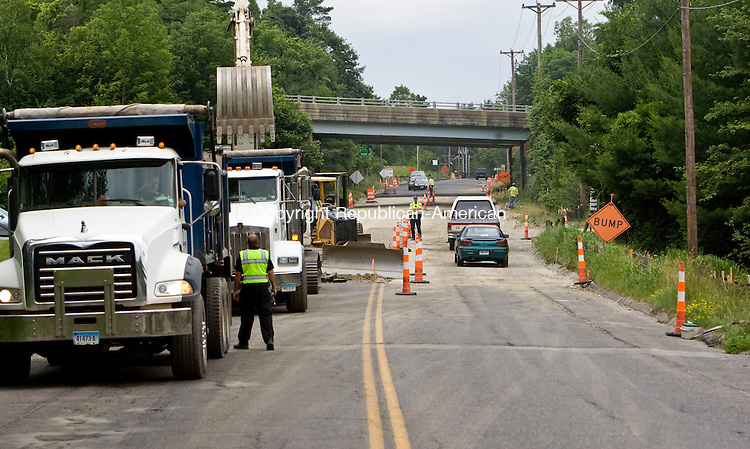 TORRINGTON, CT - 22 JUNE 2010 -062210JT03-<br /> A section of Pinewoods Road is under construction on Tuesday as it undergoes reconstruction in Torrington. <br /> Josalee Thrift Republican-American