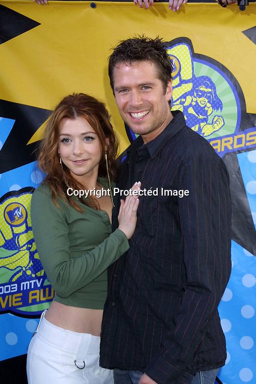 "©2003 KATHY HUTCHINS  / HUTCHINS PHOTO.""2003 MTV MOVIE AWARDS"".SANTA MONICA ,CA. MAY 31, 2003.ALEXIS DENISOF  AND ALYSON HANNIGAN"