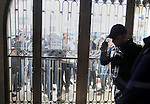 A Palestinian police officer stands guard as Palestinian protesters look through broken glass doors of a gate at a hotel where a group of Israeli and Palestinian peace activists hold a meeting in the West Bank city of Ramallah, Thursday, Jan. 9, 2014. Protesters said they object to attempts at normalizing Israeli-Palestinian relations at a time when Israel's military occupation of Palestinian lands continues. Photo by Issam Rimawi