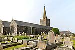 Spire and gravestones village parish church at St Keverne, Lizard Peninsula, Cornwall, England, UK