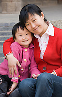 Mother and child at Small Wild Goose Pagoda, Xian. China has a one child family planning policy to reduce population.