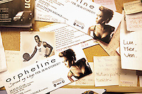 Switzerland. Canton Ticino. Aranno. Orpheline at home. Orpheline is a composer, song writer, a singer and a musician. She is a young woman (24 years old). Her mother is swiss and her father was a black american citizen. Mixed race. Picture of her deceased father when he used to be a basketball player. Leaflet for her concerts's dates in Switzerland. Aranno is located in the Malcantone area. 19.03.2010 © 2010 Didier Ruef