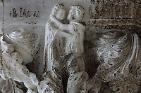 Sculpted capital of a couple kissing, carved 1340-1355, thought to be by Filippo Calendario, 1315-55, from Column 24, depicting Phases in Fathering, of the ground floor Piazzetta San Marco columns, on the Doge's Palace or Palazzo Ducale, begun 1340 and built in Venetian Gothic style, Venice, Italy. The palace has 2 arcades with 14th and 15th century capitals and sculptures, and a loggia above with a decorative brickwork facade. It was the residence of the Doge of Venice, the supreme authority of the former Republic of Venice, until the Napoleonic occupation in 1797, and is now a museum. The city of Venice is an archipelago of 117 small islands separated by canals and linked by bridges, in the Venetian Lagoon. The historical centre of Venice is listed as a UNESCO World Heritage Site. Picture by Manuel Cohen