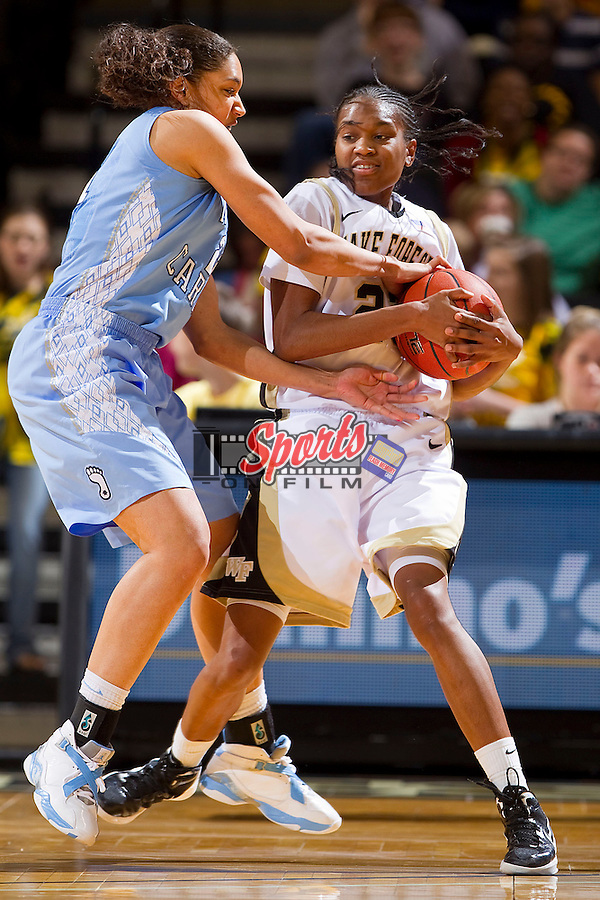 Secily Ray #23 of the Wake Forest Demon Deacons tries to keep the ball away from Krista Gross #21 of the North Carolina Tar Heels at the LJVM Coliseum on January 29, 2012 in Winston-Salem, North Carolina.  The Tar Heels defeated the Demon Deacons 75-71.    (Brian Westerholt / Sports On Film)