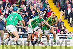Jordan Brick Kilmoyley in action against Liam Boyle and David O'Grady Ballyduff in the County Senior Hurling Final at Austin Stack Park on Sunday.