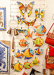 Close up of shop display of ceramic pottery souvenir products of butterflies and fish  on sale, city of Evora, Alto Alentejo, Portugal, southern Europe