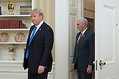 US President Donald J. Trump (L) and US Vice President Mike Pence (R) enter the Oval Office for the swearing-in of Rex Tillerson (not pictured) as US Secretary of State, at the White House in Washington, DC, USA, 01 February 2017. Tillerson was confirmed by the Senate, 01 February, in a 56-to-43 vote to become the nation's 69th Secretary of State.<br /> Credit: Michael Reynolds / Pool via CNP
