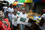 "Members of ""Daughters of the King,"" a girls' organization that carries out public education about HIV and AIDS, marches through the market in Kakata, Liberia, singing and chanting about the disease and how to prevent it. The group  is sponsored by the HIV/AIDS Program of the Lutheran Church in Liberia."