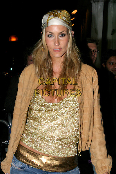 LISA BUTCHER.Sports Illustrated Swimsuit Issue 2004 - launch & 40th anniversary party.half length, half-length, gold belt, bandana, scarf.www.capitalpictures.com.sales@capitalpictures.com.© Capital Pictures.