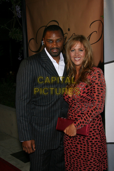 "RODNEY VAN JOHNSON & CARMEN.NBC's Hit Daytime Dramas ""Days of Our Lives"" and ""Passions"" Pre-Emmy Party - Arrivals held at French 75 Bistro, Burbank, California, USA..April 27th, 2006.Photo: Zach Lipp/AdMedia/Capital Pictures.Ref: ZL/ADM.half length married husband wife red grey gray.www.capitalpictures.com.sales@capitalpictures.com.© Capital Pictures."
