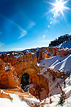 The forces of water, wind, ice, and gravity have sculpted a Natural Bridge from the sandstone of Bryce Canyon National Park, Utah.