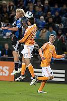San Jose Earthquakes forward Steven Lenhart (24) heads the ball over Houston Dynamo midfielder Geoff Cameron (20). The San Jose Earthquakes defeated the Houston Dynamo 2-0 at Buck Shaw Stadium in Santa Clara, California on June 4th, 2011.