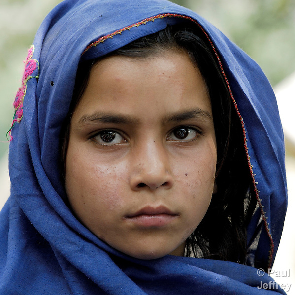 A young survivor of the October 2005 earthquake in Pakistan, back home in her mountain village of Khanian after spending months in tent camps at a lower elevation. She and her neighbors still face innumerable challenges. The quake measured 7.6 on the Richter scale and killed more than 74,000 people in northern Pakistan.