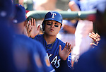 Texas Rangers' Shin-Soo Choo is greeted in the dugout during a spring training game against the Los Angeles Dodgers in Surprise, Ariz., on Saturday, March 26, 2017.<br /> Photo by Cathleen Allison/Nevada Photo Source