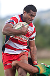 Simione Saravanua pushes off the the Drury defender on his way to scoring. Counties Manukau Club rugby Premier game between Drury and Karaka played at Drury on Saturday May 1st, 2010. Karaka won the game 32 -12 after leading 25 - 7.