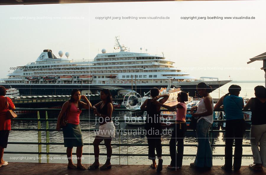 BRAZIL Amazon Manaus, cruising ship in harbour at river amazon / BRASILIEN Amazonas Manaus, Kreuzfahrtschiff im Hafen am Fluss Amazonas, die Metropole Manaus liegt am Zusammenfluss des Rio Negros und des Rio Solimões