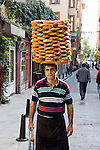Street vendor balancing a tray of simit rolls on his head in Istanbul, Turkey