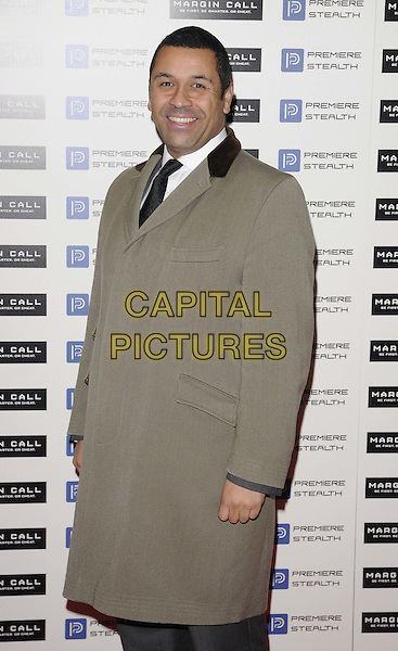 James Cleverly.The 'Margin Call' UK film premiere, Vue West End cinema, Leicester Square, London, England..January 9th, 2012.half length grey gray beige coat jacket side.CAP/CAN.©Can Nguyen/Capital Pictures.